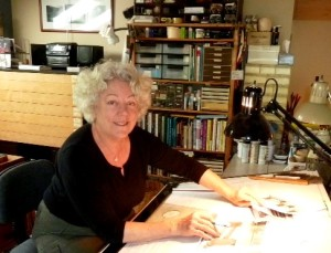 photo of Marjorie B. Kellogg at her drawing board